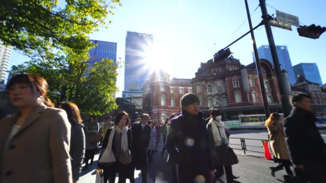 The camera goes through against the morning commute crowd.Commuters go to Marunouchi Business District from Tokyo Station.