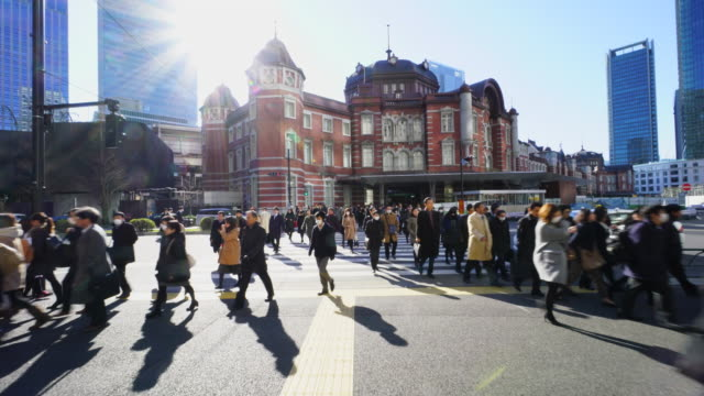 the camera goes through against the morning commute crowd.commuters go to marunouchi business district from tokyo station. - real time stock videos & royalty-free footage