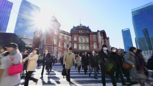 the camera goes through against the morning commute crowd.commuters go to marunouchi business district from tokyo station. - back lit stock videos & royalty-free footage