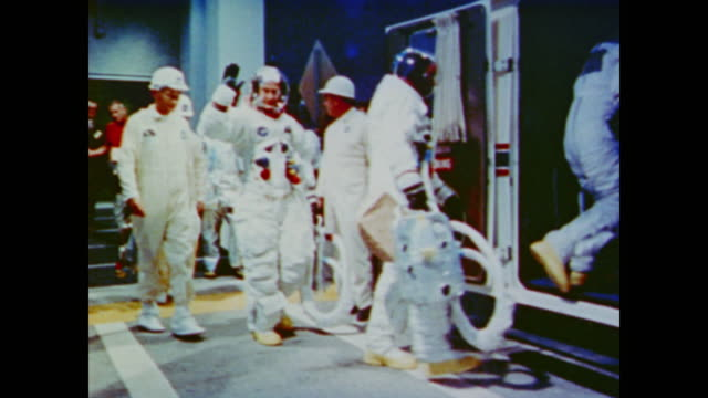 vídeos de stock e filmes b-roll de the camera later pans the empty control room and bleachers of the space center in the present - 1969