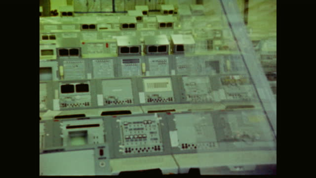 the camera pans around the empty launchpad at cape kennedy as the radio communications of the apollo moon landing are heard - electrical equipment stock videos & royalty-free footage