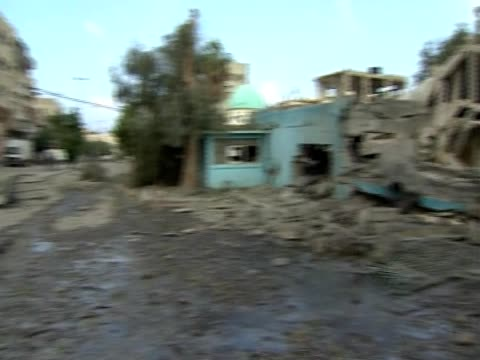 the camera pans right over the central police headquarters in gaza destroyed by an explosion - gaza strip stock videos & royalty-free footage