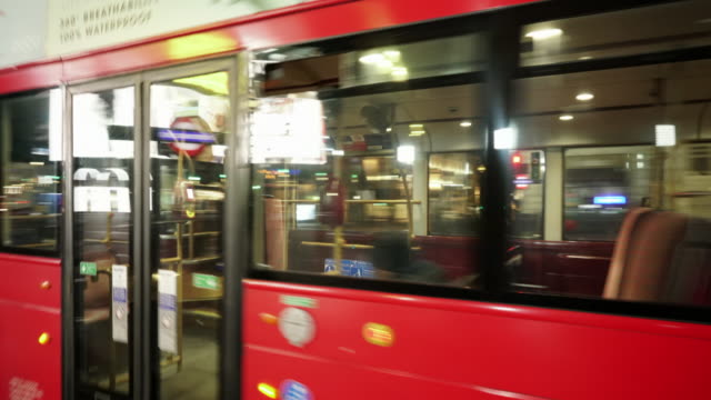 the camera pans through a deserted piccadilly circus london with empty buses, on a friday night in april 2020 - bus stock videos & royalty-free footage