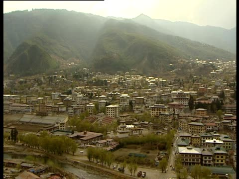 the camera pans to reveal the city of thimphu in bhutan - thimphu stock videos & royalty-free footage