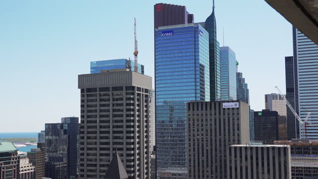 stockvideo's en b-roll-footage met the camera tilts down showing the main buildings of the financial district on may 10, 2015; in toronto, ontario, canada. the handheld image is taken... - plaatselijk monument
