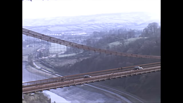 the camera tracks cars crossing the clifton suspension bridge / pan down to road below - tennessee stock videos & royalty-free footage