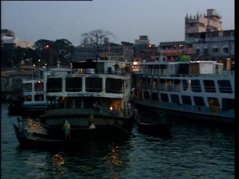 the camera travels past boats on a river - bangladesh stock videos & royalty-free footage