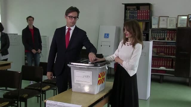 vídeos de stock, filmes e b-roll de the candidate for the left wing party in power in north macedonia stevo pendarovski votes on sunday in the second round of the presidential elections... - república da macedônia