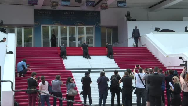 the cannes red carpet is installed in front of the festival palace before the openning ceremony - 71st international cannes film festival stock videos & royalty-free footage