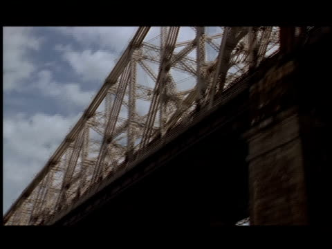 the cantilever structure of the ed koch queensborough bridge rises above the traffic deck. - cantilever stock videos & royalty-free footage