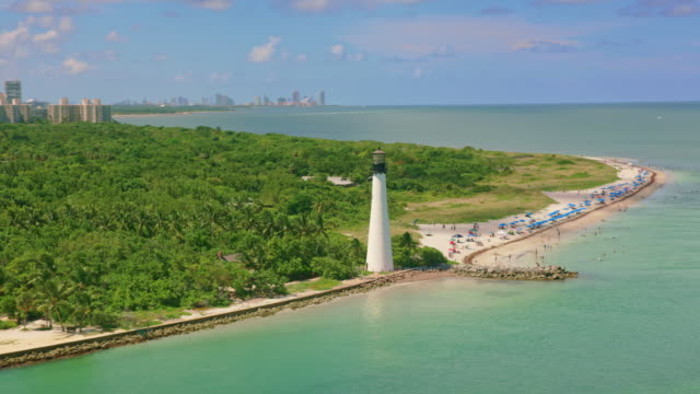 aerial the cape florida light, fl - biscayne bay stock-videos und b-roll-filmmaterial