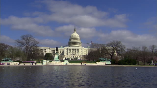 The Capitol Building rises above the Capitol Reflecting Pool in Washington, D.C.