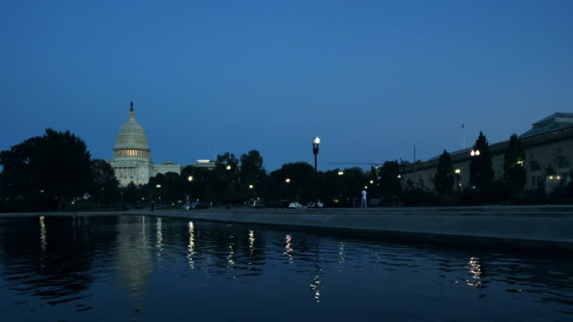 the capitol building, washington d.c, usa at dusk - reflecting pool washington dc stock videos & royalty-free footage