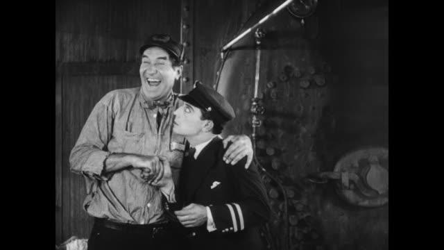 1928 the captain (ernest torrence) is pleased with his new employee (buster keaton) - 1928 stock videos & royalty-free footage