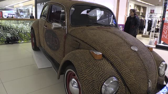 the car body covered using about 500kg pistachio shells two years ago is displayed at a shopping mall in gaziantep turkey on december 29 2016 - pistazie stock-videos und b-roll-filmmaterial