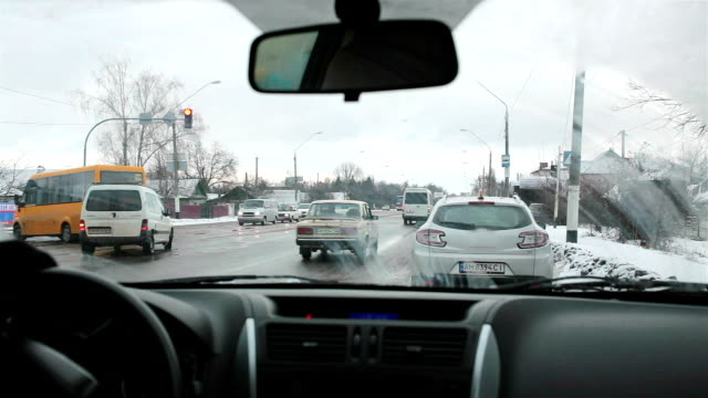 the car continues driving after stopping on the side of the road. - windscreen stock videos & royalty-free footage