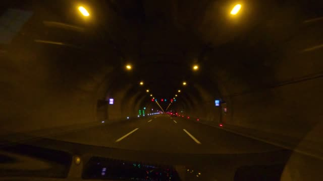 the car is going in the dark tunnel. - light at the end of the tunnel stock videos & royalty-free footage