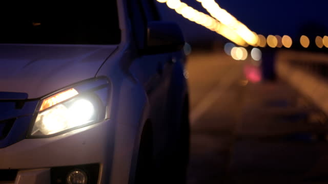 the car turned on the turn signal for a turn signal. - headlight stock videos and b-roll footage