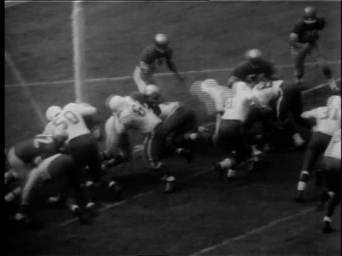 the cardinals' joe childress blasting into the end zone to score / united states - 1958 stock videos & royalty-free footage