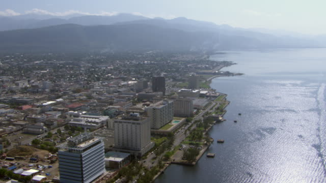 the caribbean sea stretches along the city of kingston, jamaica. - jamaica stock videos & royalty-free footage