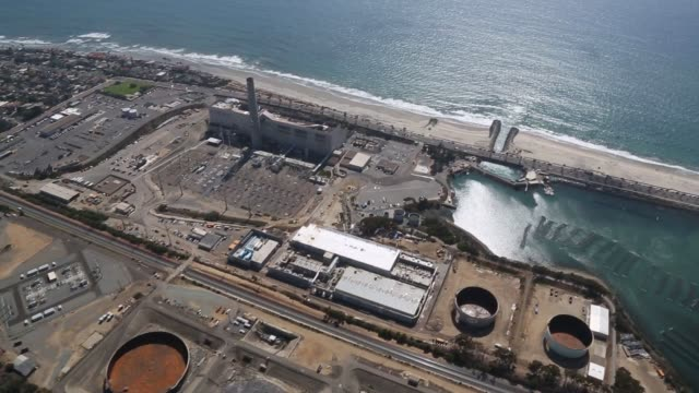 the carlsbad desalination plant under construction next to the encina power station and agua hedionda lagoon in this aerial video taken over... - carlsbad california stock videos & royalty-free footage