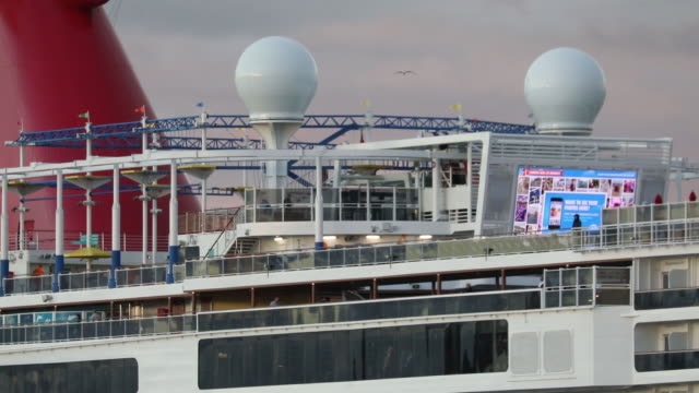 the carnival corp. carnival panorama cruise ship holds passengers on board while docked at the long beach cruise terminal after a passenger was taken... - schiffsdeck stock-videos und b-roll-filmmaterial