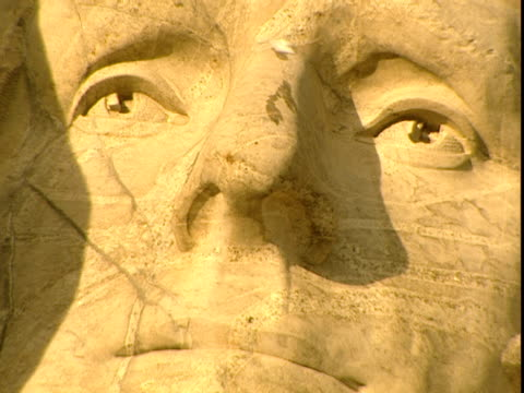 the carved face of u.s. president thomas jefferson gazes out from mount rushmore. - thomas jefferson stock videos & royalty-free footage
