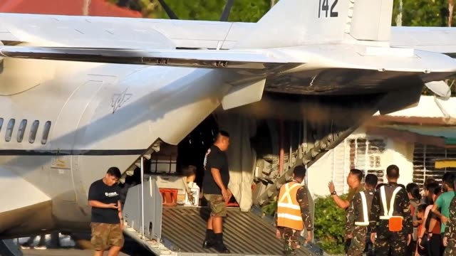 the casket of the killed dutch birdwatcher is loaded to an military aircraft to be transported off the jolo island of the philippines - bird watching stock videos & royalty-free footage