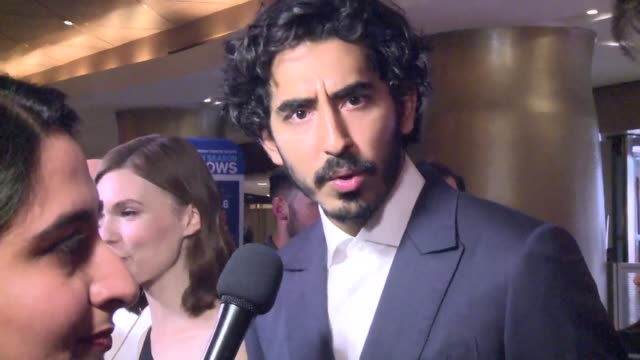 The cast and crew of the film Hotel Mumbai take to the red carpet at the Toronto International Film Festival