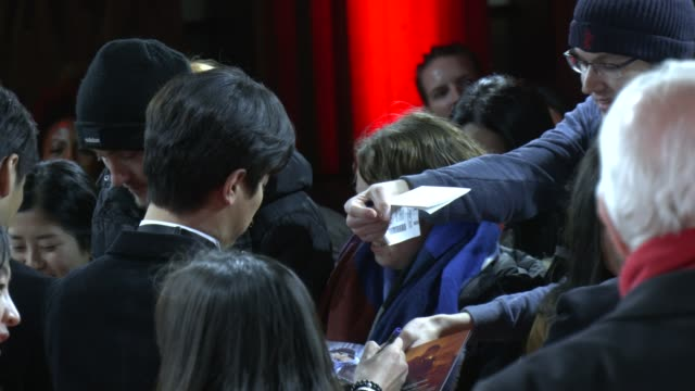 the cast gives autographs at the time to hunt premiere during the 70th berlinale international film festival berlin at friedrichstadt palast on... - 有名人のサイン点の映像素材/bロール