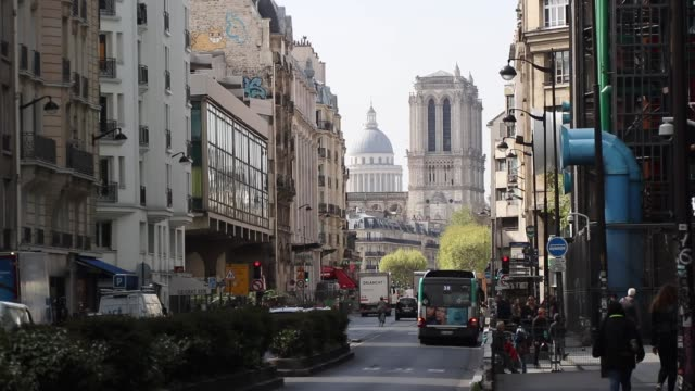 the cathedral notre-dame without roof north side of the cathedral with the pantheon in the background and the pipes of the pompidou center in the... - pantheon paris stock videos & royalty-free footage