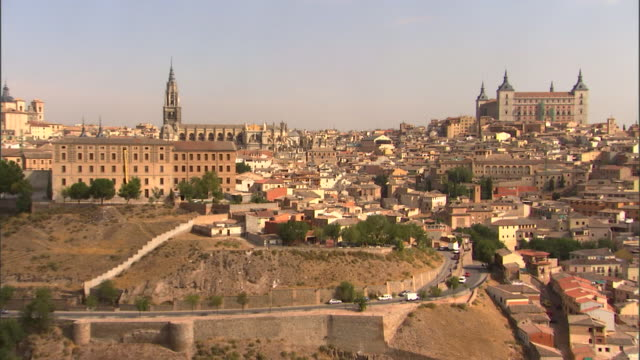 The Cathedral of Toledo and Alcazar Castle stand on a hill in Toledo, Spain.