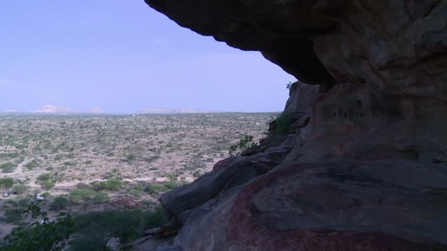 stockvideo's en b-roll-footage met the cave paintings at laas geel in the self declared state of somaliland retain their fresh brilliance providing vivid depictions of a pastoralist... - geproduceerd segment