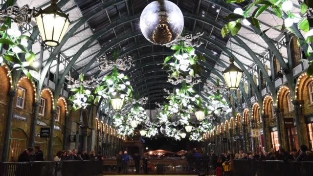 The ceiling of Covent Garden Market is lined with giant mistletoe as part of it's Christmas light display on December 8 2015 in London England...