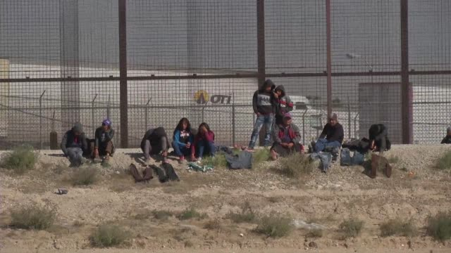 the central american migrants wait at the us mexican border facing a desperate situation that their chances of entering the united states are almost... - mexican american stock videos & royalty-free footage