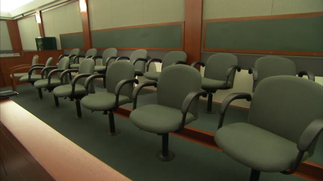the chairs of a jury box are empty. - court room stock videos & royalty-free footage