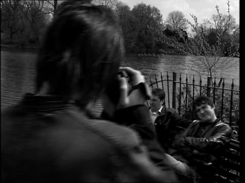 the charlatans release new album itn london band member filming other members of band sitting beside lake in park tim burgess interviewed sot reasons... - album title stock videos and b-roll footage