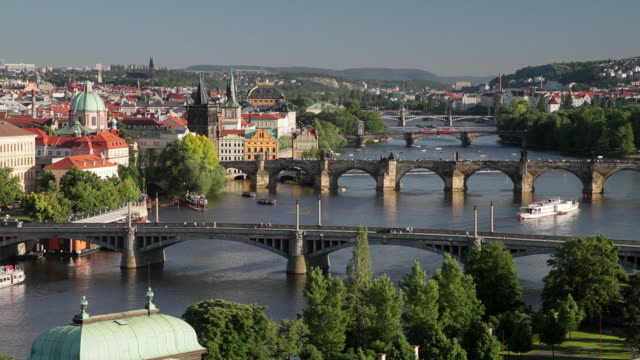 the charles bridge spans the river vltava in prague. - charles bridge stock videos & royalty-free footage