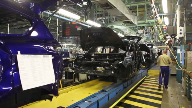 The chassis for Ford automobiles move along the production line in the Ford Espana SL plant operated by Ford Motor Co in Almusafes Spain on Thursday...