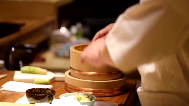 the chef makes sushi in the restaurant on may 11 2017 in shanghai china - sushi video stock e b–roll