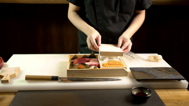 the chef prepares raw food and ingredient at the japanese restaurant - ricci di mare video stock e b–roll