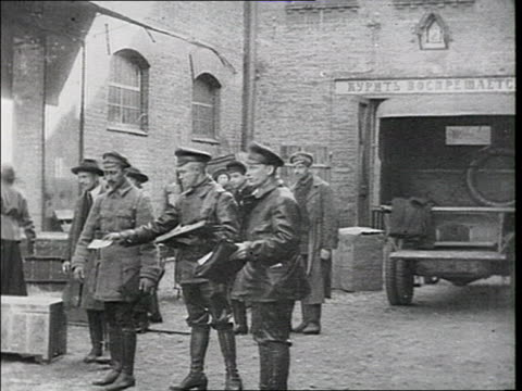 state police agents enter a shed or warehouse men leave the house holding a trunk cheka policemen open the trunk and search it the vtchk committee... - 1918 stock videos & royalty-free footage
