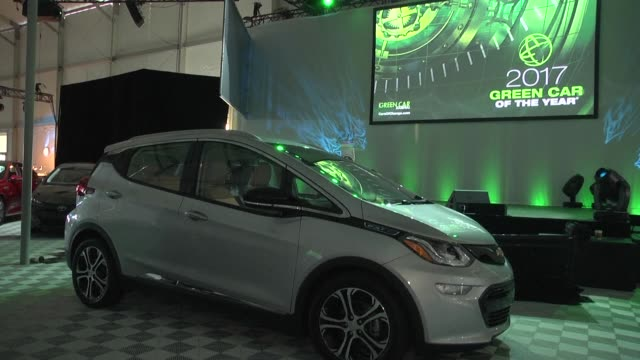 the chevrolet bolt ev wins the 2016 green car of the year award in los angeles beating out the bmw 330e iperformance the chrysler pacifica the kia... - chevrolet stock videos & royalty-free footage