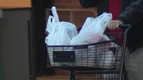 the chicago city council approved a plastic bag ban on april 30, 2014. retailers occupying stores that are more than 10,000 square foot will no... - plastic bag stock videos & royalty-free footage
