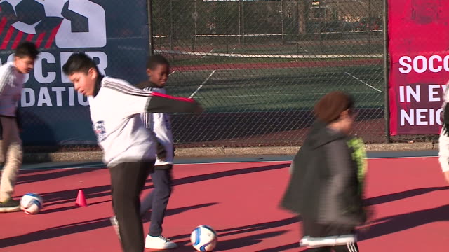 wgn the chicago fire soccer club in conjunction with the us soccer foundation and the city of chicago announced dec 6 plans to build 50 minipitches... - impact stock videos & royalty-free footage
