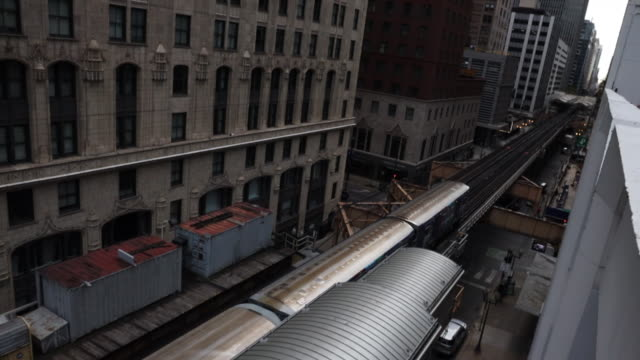 the chicago loop train between buildings taken from high angle view. - urban sprawl stock videos & royalty-free footage