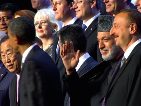 the chicago nato summit family photo. first row - luxembourg, bahrain, bulgaria, poland, yugoslav, turkey, slovakia, czech, un, usa, sec. gen,... - north atlantic ocean stock videos & royalty-free footage