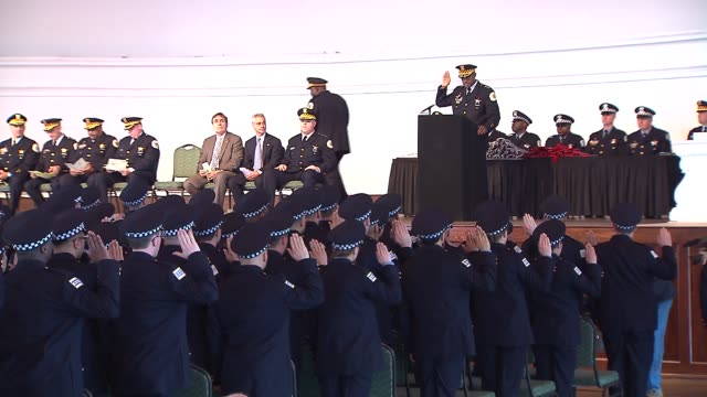 the chicago police department held a graduation ceremony for its recruits at navy pier on april 21, 2014 in chicago, illinois. mayor rahm emanuel... - military recruit stock-videos und b-roll-filmmaterial