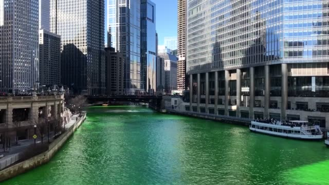 the chicago river was dyed green in honour of st. patrick's day, as the city prepared for its parade. the city has been dyeing the river green since... - chicago river stock videos & royalty-free footage