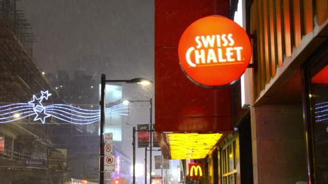 the chicken specialty restaurant is one of the most popular in the canadian city. the image is taken while there is a snowstorm during the nighttime.... - focus on foreground stock videos & royalty-free footage